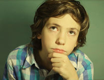 Preteen handsome boy think over difficult issue Royalty Free Stock Photography