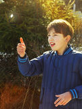 Preteen handsome boy toss a coin Royalty Free Stock Photo