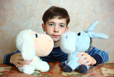 Preteen handsome boy with toys Stock Photo
