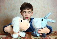 Preteen handsome boy with toys Royalty Free Stock Photography