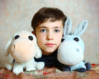Preteen handsome boy with toys Royalty Free Stock Image