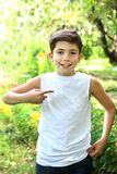 Preteen handsome boy in white tshirt free of inscription Royalty Free Stock Image