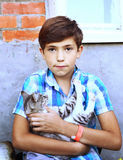 Preteen handsome country boy with kitten close up portrait Stock Photo