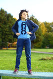 Preteen hansome boy in blue jeans and jacket Stock Photos