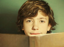 Preteen hansome boy reading book Stock Images