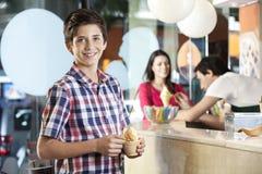 Preteen Happy Boy Having Ice Cream At Parlor Stock Photography