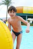 Preteen little boy in open air aqua park. Preteen little boy in aqua  park Royalty Free Stock Photo