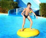 Preteen little boy in open air aqua park stock photography