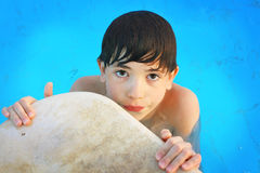 Preteen little boy in open air aqua park Stock Images