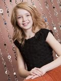 Preteen Model 2. Beautiful young girl posing for the camera in her holiday dress Stock Photography