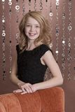 Preteen Model 3. Beautiful young girl posing for the camera in her holiday dress Stock Photos