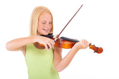 Preteen playing violin Royalty Free Stock Photography