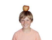 Preteen with a red apple on his head. Isolated on white background Stock Photography