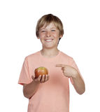 Preteen with a red apple Royalty Free Stock Photos