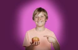 Preteen with a red apple Royalty Free Stock Image