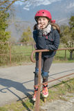 Preteen with roller skate helmet, eat a cake Royalty Free Stock Images