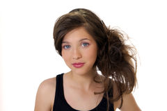 Preteen School Girl. Pretty preteen school girl model with new hairstyling Royalty Free Stock Images