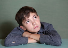 Preteen schoolboy close up thinking portrait Royalty Free Stock Photo