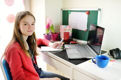 Free Preteen Schoolgirl Doing Her Homework With Laptop Computer At Home. Child Using Gadgets To Study. Online Education And Distance Royalty Free Stock Images - 177472159