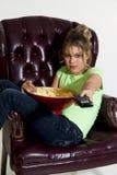 Preteen/TV/Popcorn Stock Images