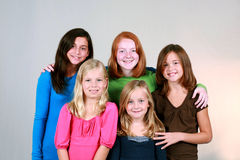 Preteens. Diverse group of pretty preteen girls smiling Stock Photo