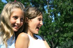 Preteens having fun. Two young girls having fun and laughing Royalty Free Stock Image