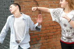 Pretend Fight. Teenage Boy and Girl pretend to fight and horse around stock photography