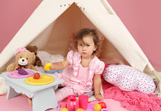Pretend Play Tea Party at home with a TeePee Tent Royalty Free Stock Images