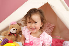 Pretend Play Tea Party at home with a TeePee Tent Stock Image