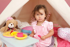 Pretend Play Tea Party at home with a TeePee Tent Stock Photo