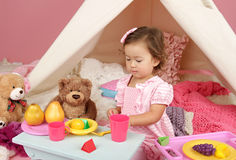 Pretend Play Tea Party at home with a TeePee Tent Stock Photography