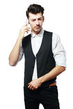 Pretend talking telephone. Man holding pretend talking telephone over white Royalty Free Stock Photography