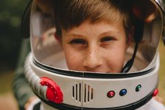 Pretending to be an astronaut stock photography