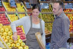 Pretending to buy fruits. Vendor royalty free stock image