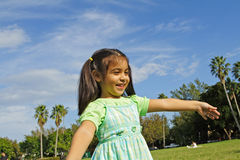 Pretending to Fly. Girl in a park pretending to fly Stock Photos