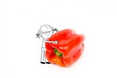 Pretmeisje het spelen met Spaanse peper op witte achtergrond wordt geïsoleerd die - Stock Afbeelding