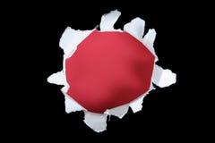Preto e vermelho rasgados para fora fure Fotografia de Stock