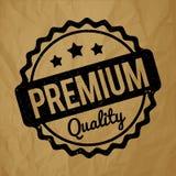 Preto superior do carimbo de borracha da qualidade em um fundo marrom de papel amarrotado Fotografia de Stock Royalty Free