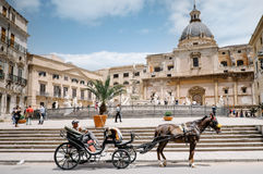 Pretoria Fountain, Palermo. Palermo, Italy - May 12, 2016: Coachman with horse and carriage waiting for the tourists in front of the Pretoria fountain, Palermo Stock Images