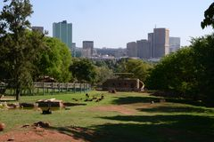 Pretoria Zoo. Skyline of Pretoria, capital of South Africa, with the Pretoria Zoo in foreground Royalty Free Stock Photography