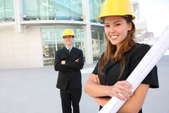 Prettey Woman Architect. On Construction site with co-worker in background stock photography