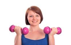 Prettty teenage girl exercising Stock Photos