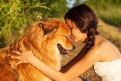 Prettty Young Girl Hugging Her Cute Dog Royalty Free Stock Image