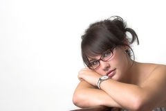 Pretty. Beautiful girl sitting on the chair with her head on her shoulder Stock Photography