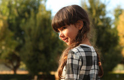 Pretty 6-year-old girl in brunette braids Stock Photo