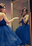 Pretty. Brunette looking at the mirror - vintage look stock photo