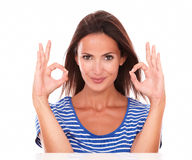 Pretty adult lady gesturing ok sign Stock Photo