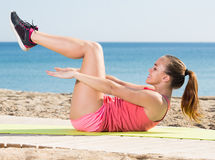 Pretty adult sporty woman exercising royalty free stock image