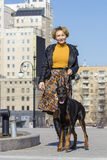 Pretty adult woman with dog outdoors Royalty Free Stock Photos