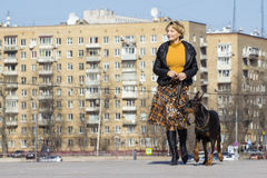 Pretty adult woman with dog outdoors Royalty Free Stock Photography